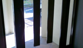 Glass entrance door (wood paneling)