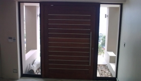 Slatted  wooden entrance door